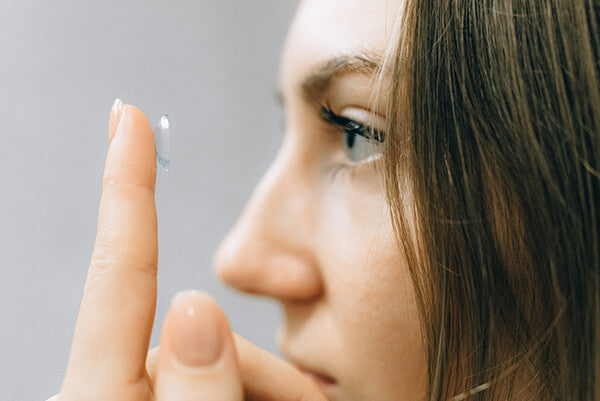 A girl who is wearing contact lenses