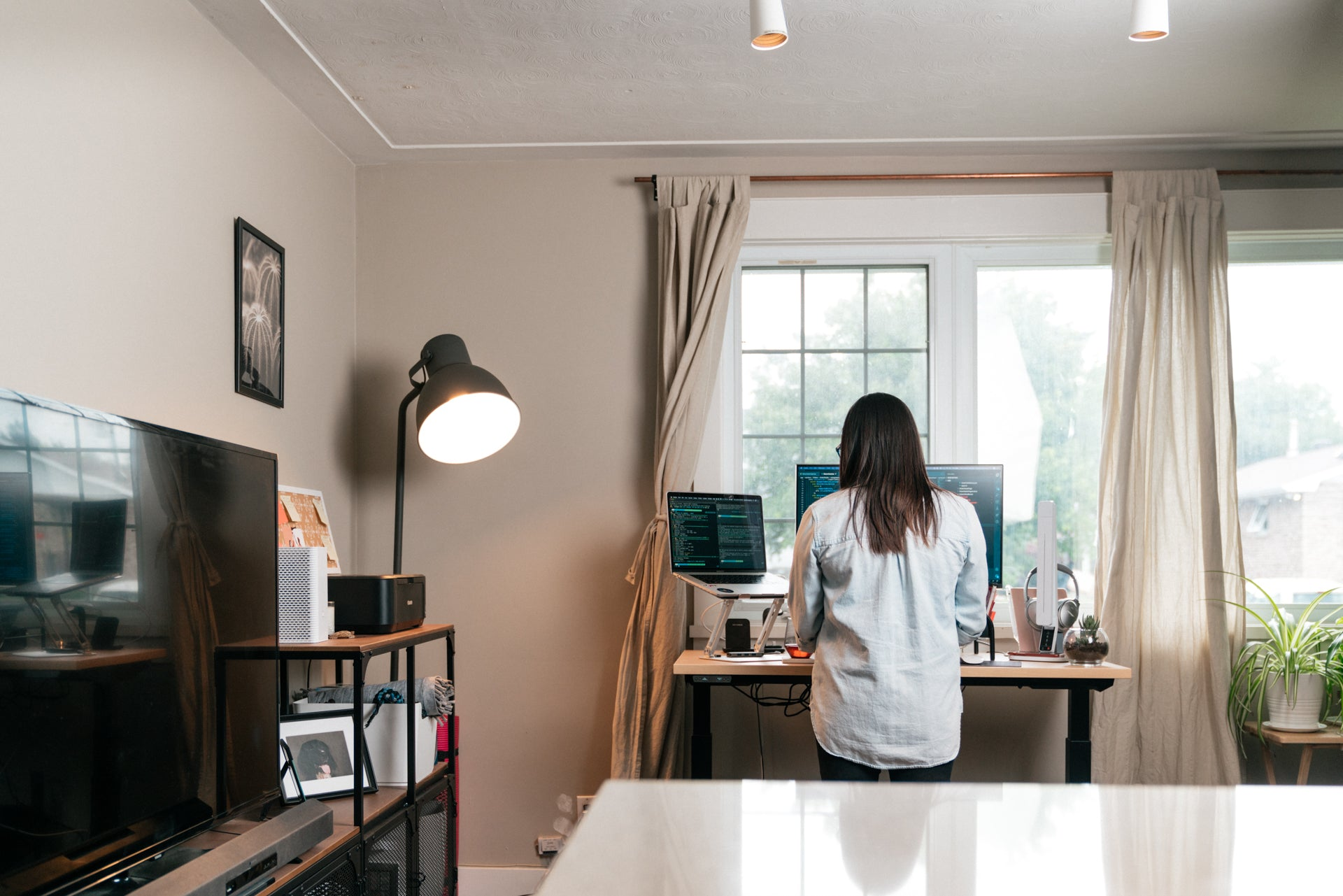 a student working at their standing desk