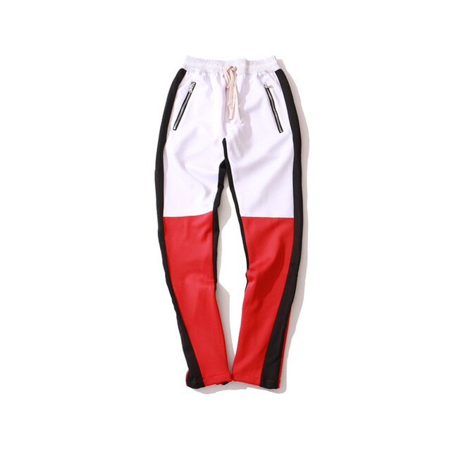 RED COLOUR-BLOCKED JOGGERS WITH BLACK STRIPE