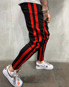 PENTAGON JOGGERS IN BLACK WITH RED STRIPE