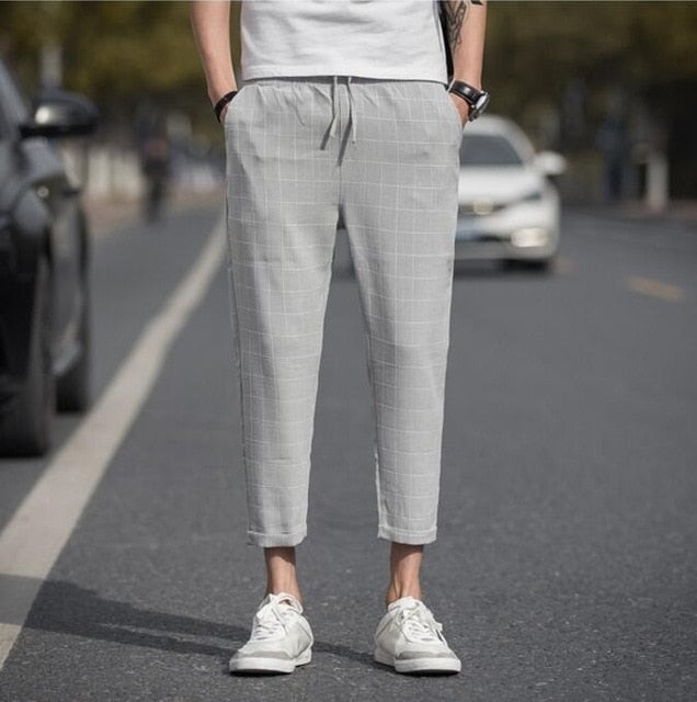 ANKLE-LENGTH PLAID TROUSERS IN LIGHT GREY
