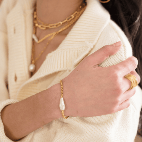 Woman in white sweater wearing Gold Plated Statement Pearl Chain Bracelet
