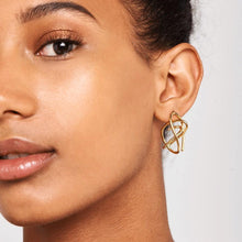 Load image into Gallery viewer, Model wearing handmade pair of 18k gold plated asymmetric coil earrings