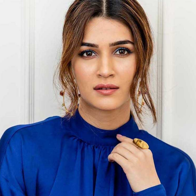 Bollywood Star Kriti Sanon wearing 18k Gold-Plated Handmade-in-Spain Charlotte Top Flat Statement Ring During Movie Promotions