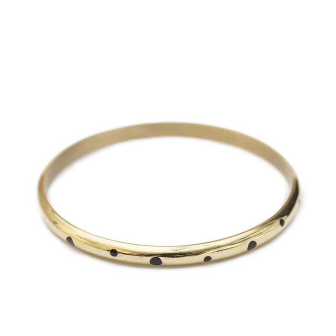 Statement-making gold plated bracelets handmade from brass with black indentations