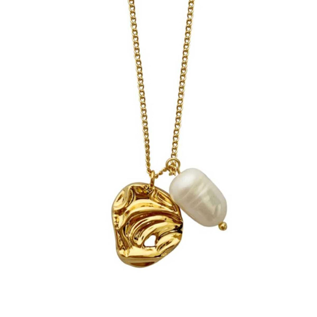 Exquisite gold plated drop necklace with freshwater pearl nestled in a delicate nest handmade from brass for everyday wear