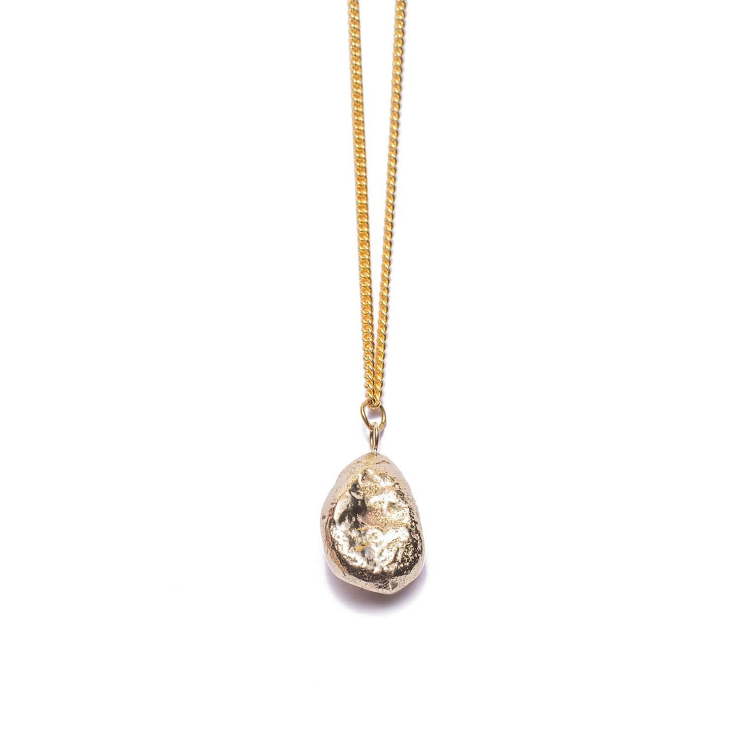 Chunky rock shaped gold plated pendant strung on a gold plated chain handmade from brass for women.
