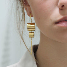 Load image into Gallery viewer, Model Wearing Tanzire's Subtle Statement-making 18k Gold Plated Dangle Earrings
