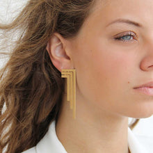 Load image into Gallery viewer, Dangle and Drop Three Line 18k Gold Plated Earrings On Model