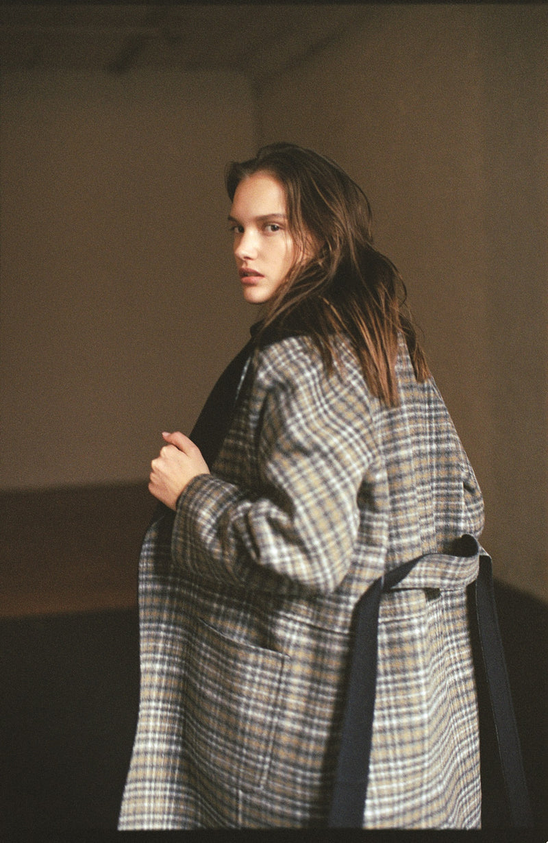 Model wearing Women Reversible Handmade Wool Long Coat in Multi Plaid/ Dark Navy (Plaid Back View)