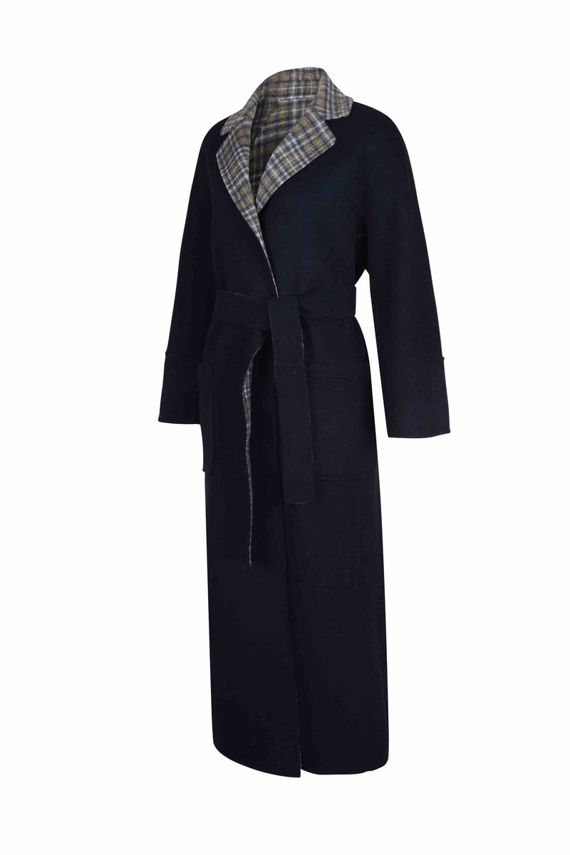 Side view of Women Reversible Handmade Wool Long Coat in Multi Plaid/ Dark Navy (Solid Side)