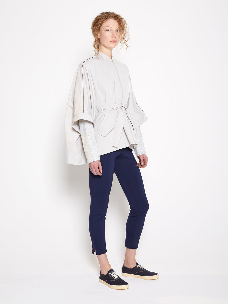 Model wearing Women Beige Drop Shoulder Jacket in Beige and Navy stretchable Leggings, Side View