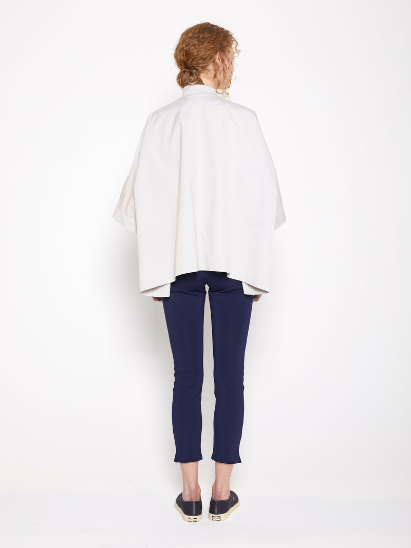 Model wearing Women Beige Drop Shoulder Jacket in Beige and Navy stretchable Leggings, Back View