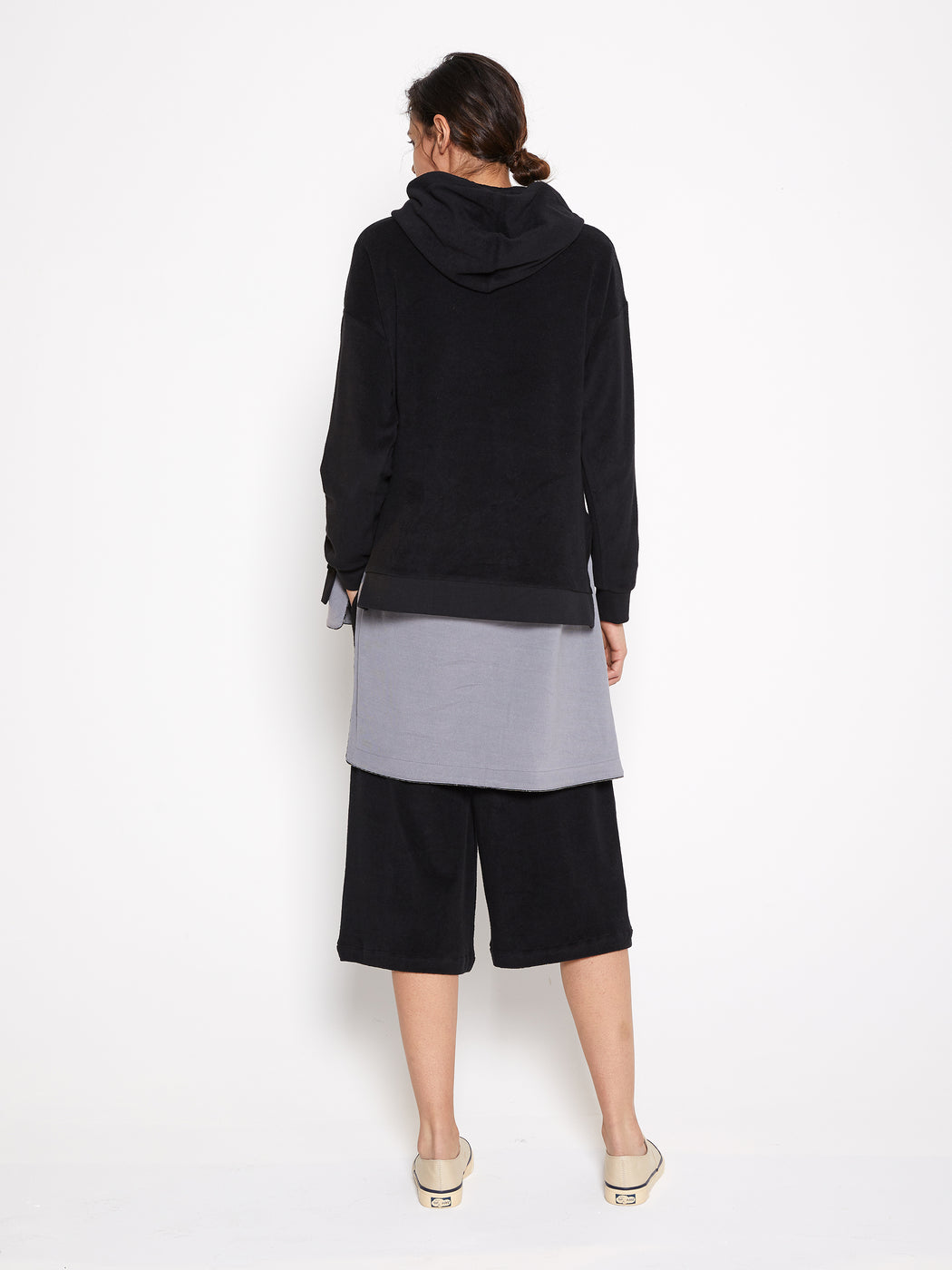 Model wearing Women Draped Collar Pullover, made with Organic Cotton in Black (Back View)