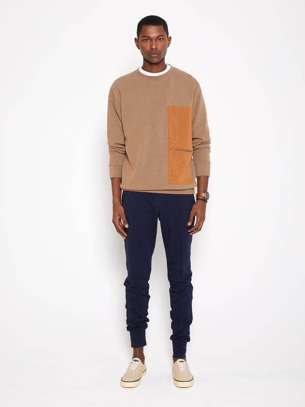 Model wearing Men Pocket Blocked Sweatshirt in Orange/ Camel (Front View)