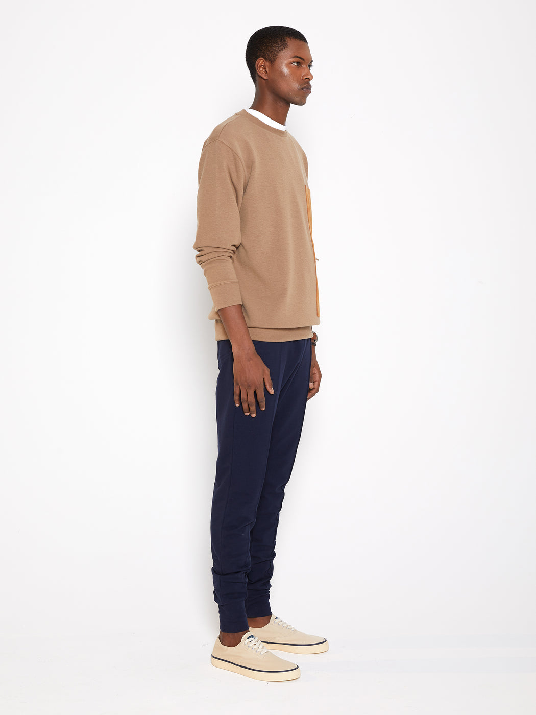 Model wearing Men Pocket Blocked Sweatshirt in Orange/ Camel (Side View)
