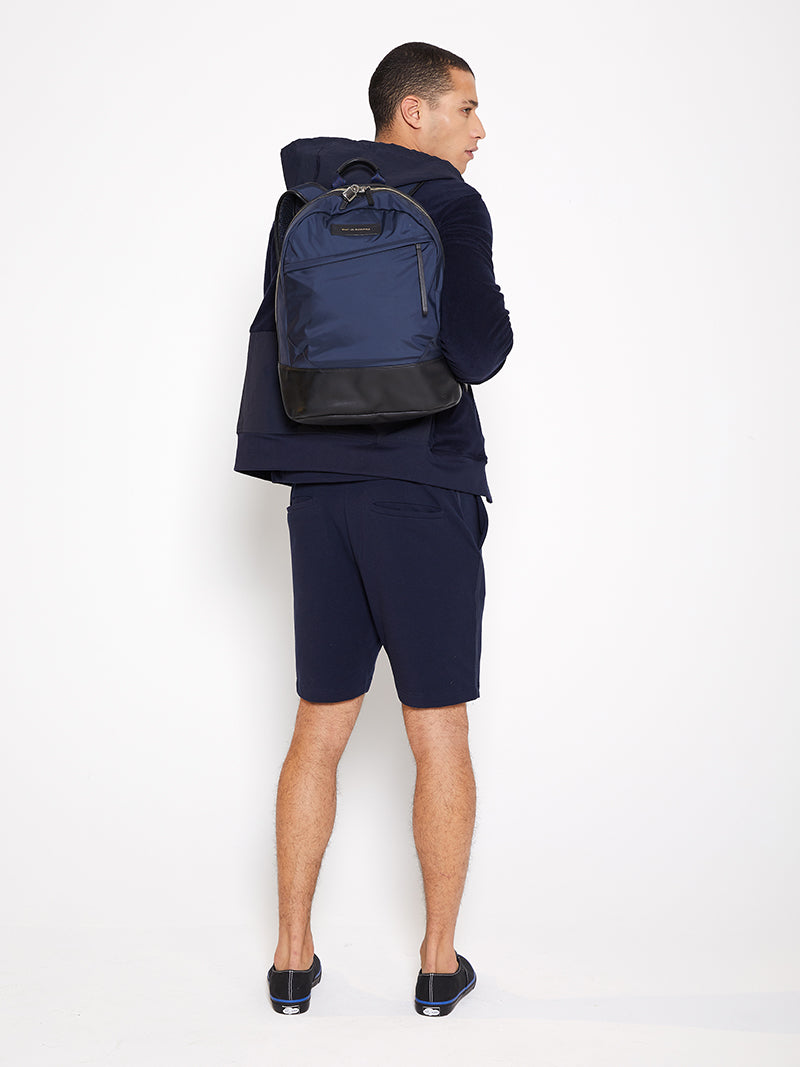 Model wearing Men Nylon Hoodie Zip-Up, made with Organic Cotton (Back View)
