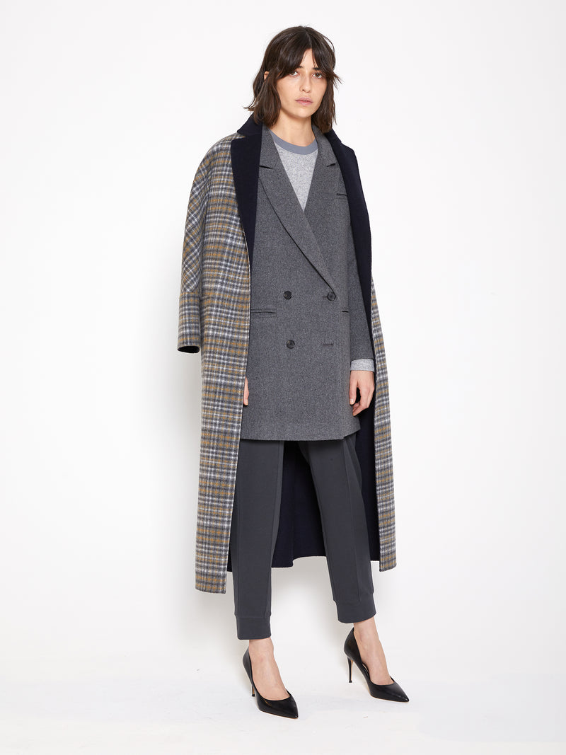 Model wearing Women Reversible Handmade Wool Long Coat in Multi Plaid/ Dark Navy (Plaid Side View)