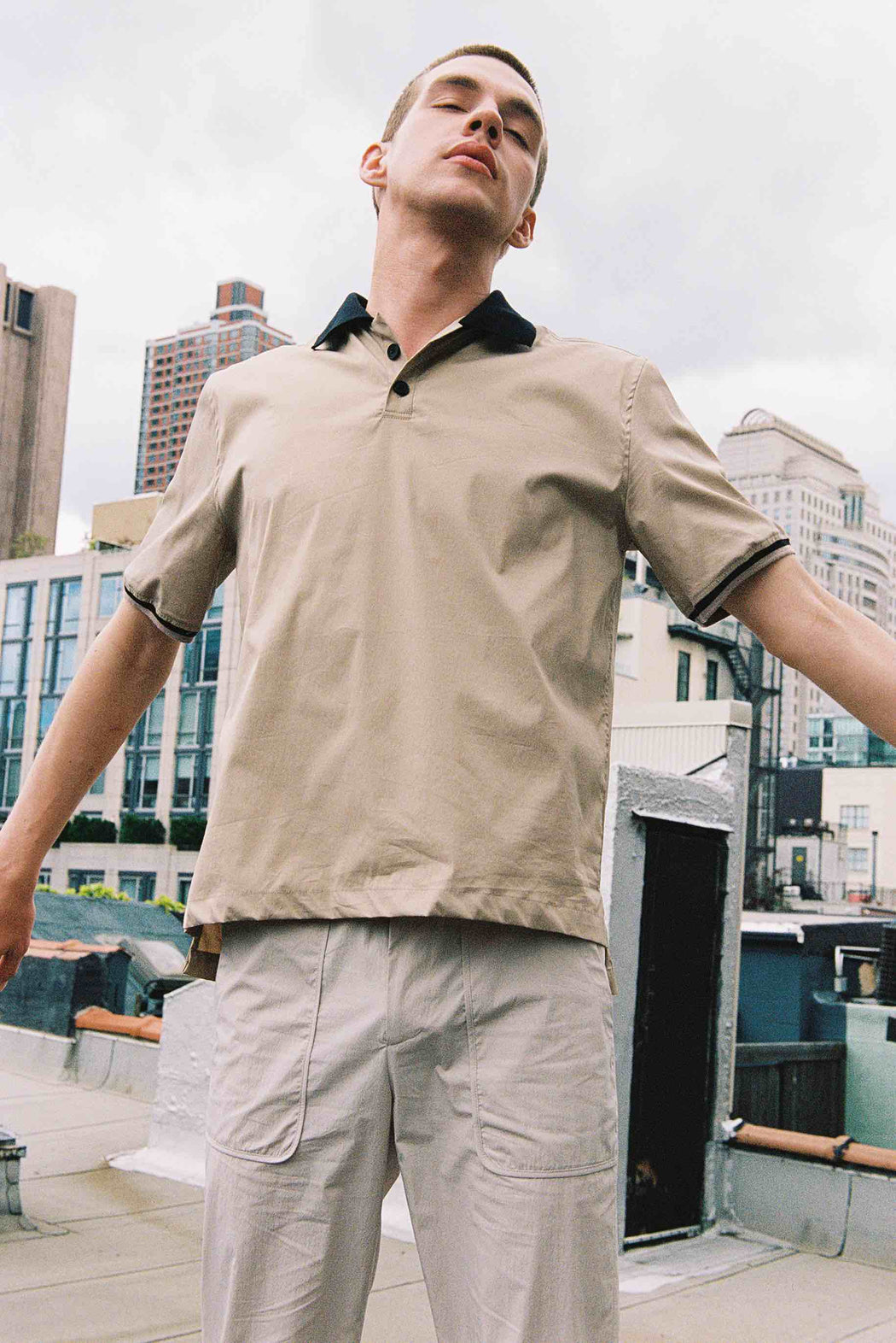 Model wearing Men Contrast Collar Polo Shirt in Beige (Front View)