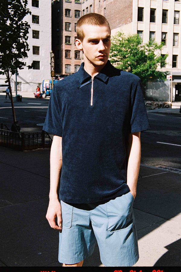 Model wearing Men Zipper Polo Terry Shirt in Navy (Front View)