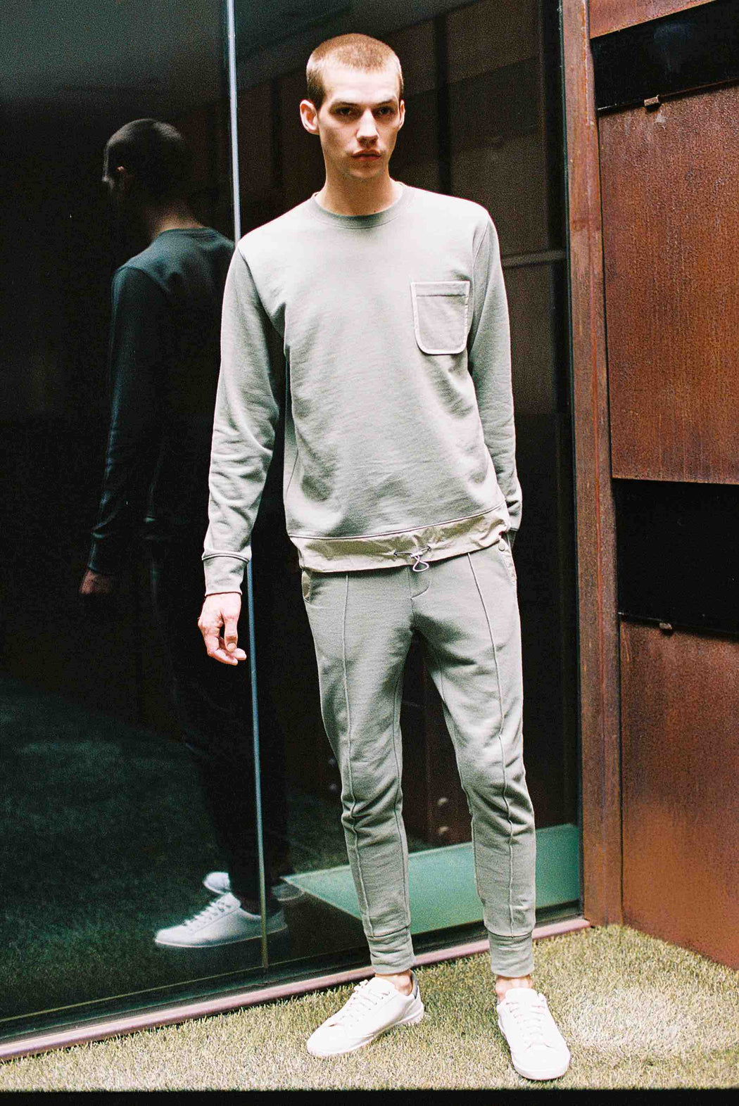 Model wearing Men Color Blocked Jogger Pants in Khaki (Front View)