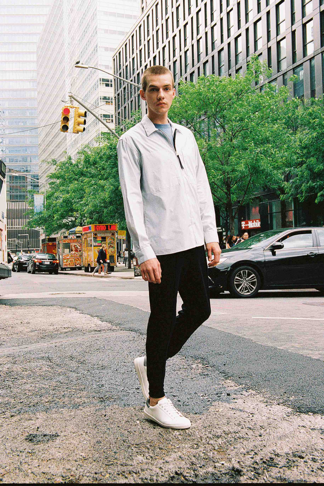 Model wearing Men Color Blocked Jogger Pants in Black (Front View)