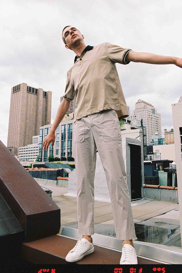 Model wearing Men High Waist Stopper Detail Pants in Beige (Front View)