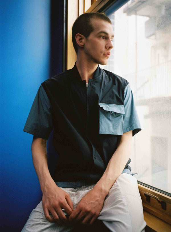 Model wearing Men Blocked Ribbed Collar Shirt in Navy (Front View)