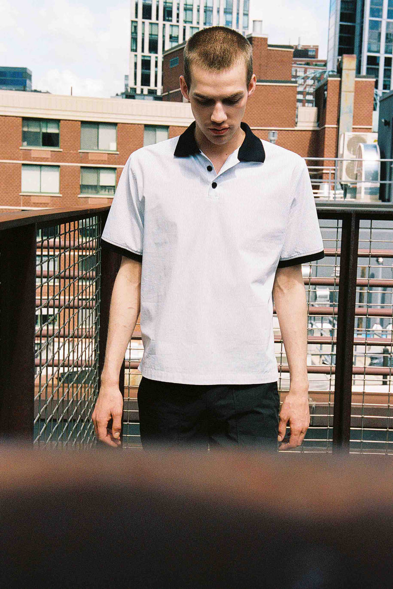 Model wearing Men Contrast Collar Stripe Polo Shirt (Front View)