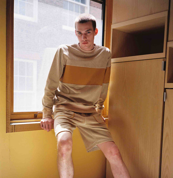 Model wearing Men Color Blocked Sweatshirt in Beige(Terry) (Front View)