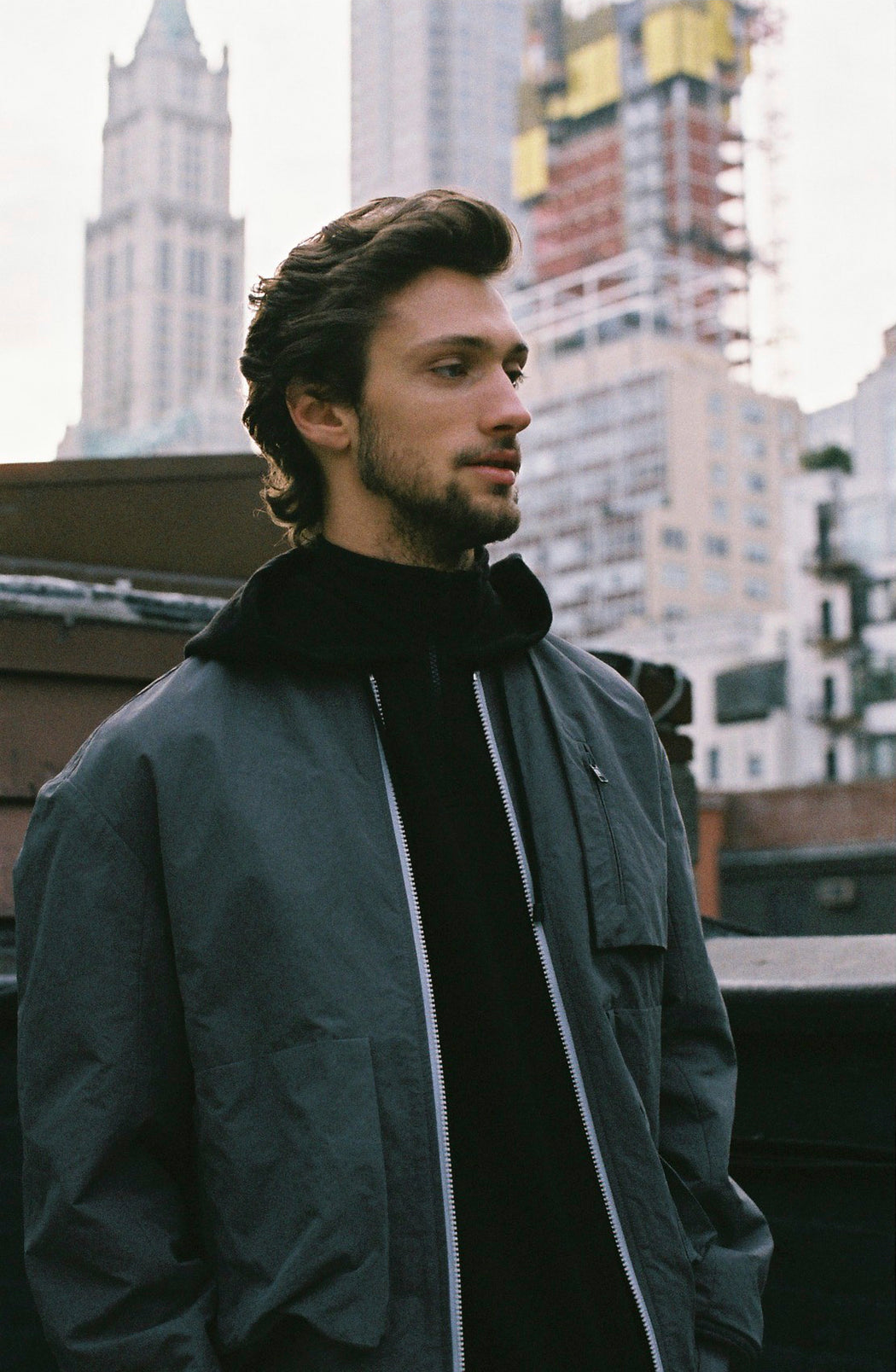 Model wearing Men Pullover Hoodie Turtleneck, made with organic cotton in Black (Front View)