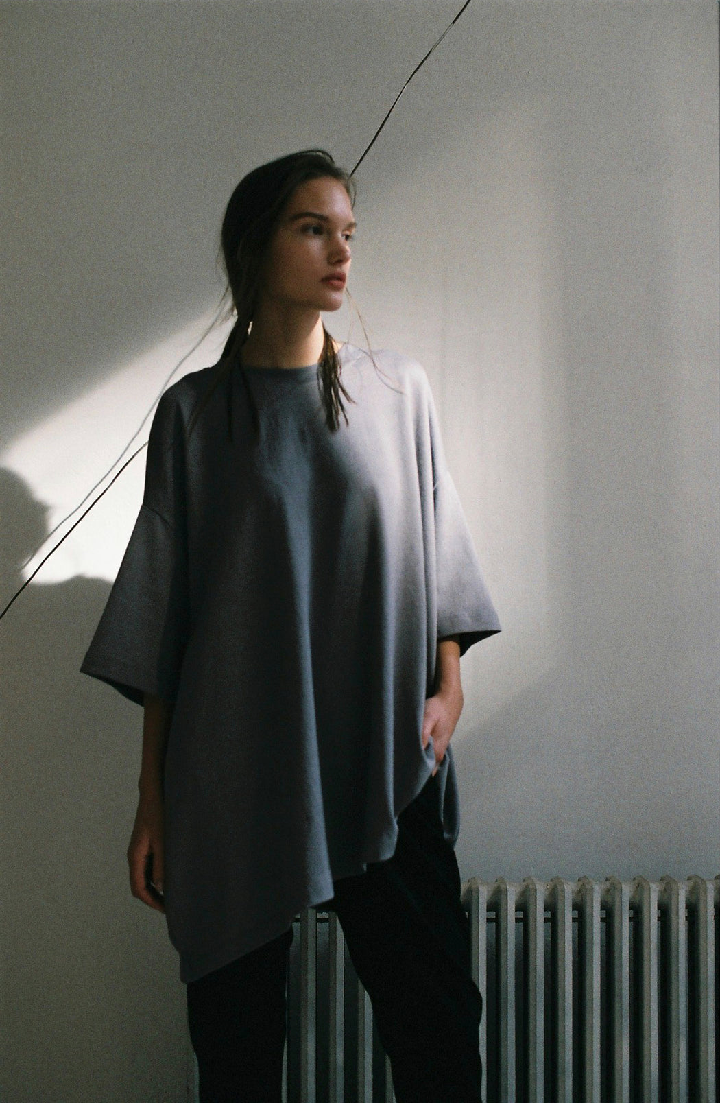 Model wearing Women Oversized Single T-Shirt, made with Organic Cotton in Grey (Front View)