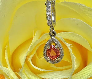 Custom Designed Orange Sapphire and Diamond Halo Pendant
