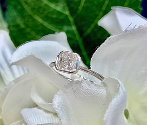 Cushion Cut, Bezel Set Engagement ring