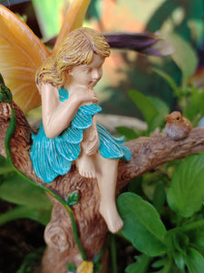 Fairy girl in blue dress sitting on a branch talking to bird | sitting pretty | MG370