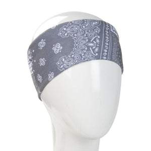 A WHITE MANNEQUIN HEAD IS WEARING A, 9.5 INCHES WIDE BY 19 INCHES LONG, STRETCHABLE INFINITY SCARF. THIS ONE IS A WHITE DESIGN ON A GREY BACKGROUND PATCHWORK MOTIF.