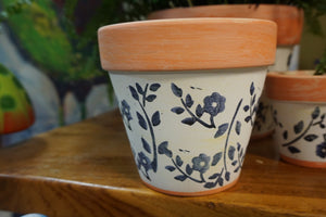 Adorable Terra Cotta planters 3 sizes  painted white with navy flowers