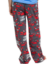 Load image into Gallery viewer, WOMAN WEARING PJ PANTS, SHOWING THE BACK SIDE: RED, UPSET-LOOKING CRABS, BLACK BACKGROUND, AND WHITE WORDS 'CRABBY IN THE MORNING'. THERE IS A RED CELL PHONE POCKET ON THE RIGHT HIP AND A DRAWSTRING IN A RED ELASTIC BAND AT THE WAIST. THIS IS PRESHRUNK, NO FADE PEINT MATERIAL, AND COMES IN 5 SIZES XS, S, M, L, XL.