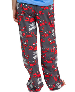 WOMAN WEARING PJ PANTS, SHOWING THE BACK SIDE: RED, UPSET-LOOKING CRABS, BLACK BACKGROUND, AND WHITE WORDS 'CRABBY IN THE MORNING'. THERE IS A RED CELL PHONE POCKET ON THE RIGHT HIP AND A DRAWSTRING IN A RED ELASTIC BAND AT THE WAIST. THIS IS PRESHRUNK, NO FADE PEINT MATERIAL, AND COMES IN 5 SIZES XS, S, M, L, XL.