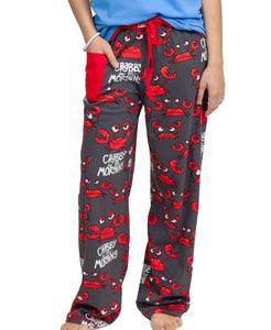 WOMAN WEARING PJ PANTS, SHOWING THE FRONT SIDE: RED, UPSET-LOOKING CRABS, BLACK BACKGROUND, AND WHITE WORDS 'CRABBY IN THE MORNING'. THERE IS A RED CELL PHONE POCKET ON THE RIGHT HIP AND A DRAWSTRING IN A RED ELASTIC BAND AT THE WAIST. THIS IS PRESHRUNK, NO FADE PEINT MATERIAL, AND COMES IN 5 SIZES XS, S, M, L, XL.