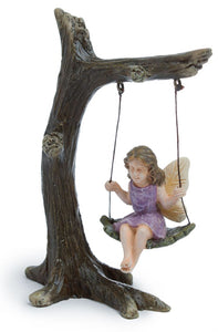 Fairy girl sitting in a tree swing in pink dress - MG12