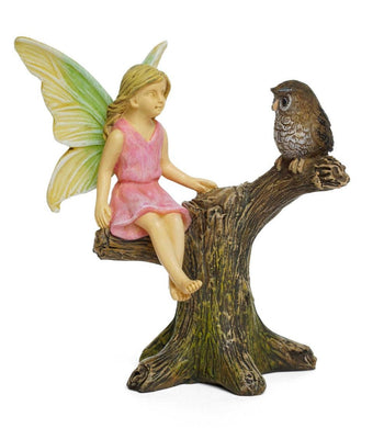 Fairy with Owl Sitting in on a tree branch