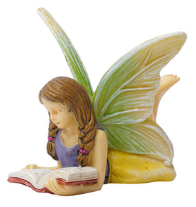 Fairy laying down reading a book MG315