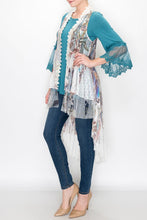 Load image into Gallery viewer, FRONT VIEW OF IVORY LACE JACKET-VEST/LONG LACE HEM | LONGER IN BACK THAN IN FRONT | SIZES S, M, L, PLUS| SCALLOPED, LACE, RUFFLE TRIM/FLORAL AND FEATHERS PRINT | TEAL BLOUSE (LONG LACE CUFFS)/SKINNY-LEGGED BLUE JEANS/TAN HIGH HEELS