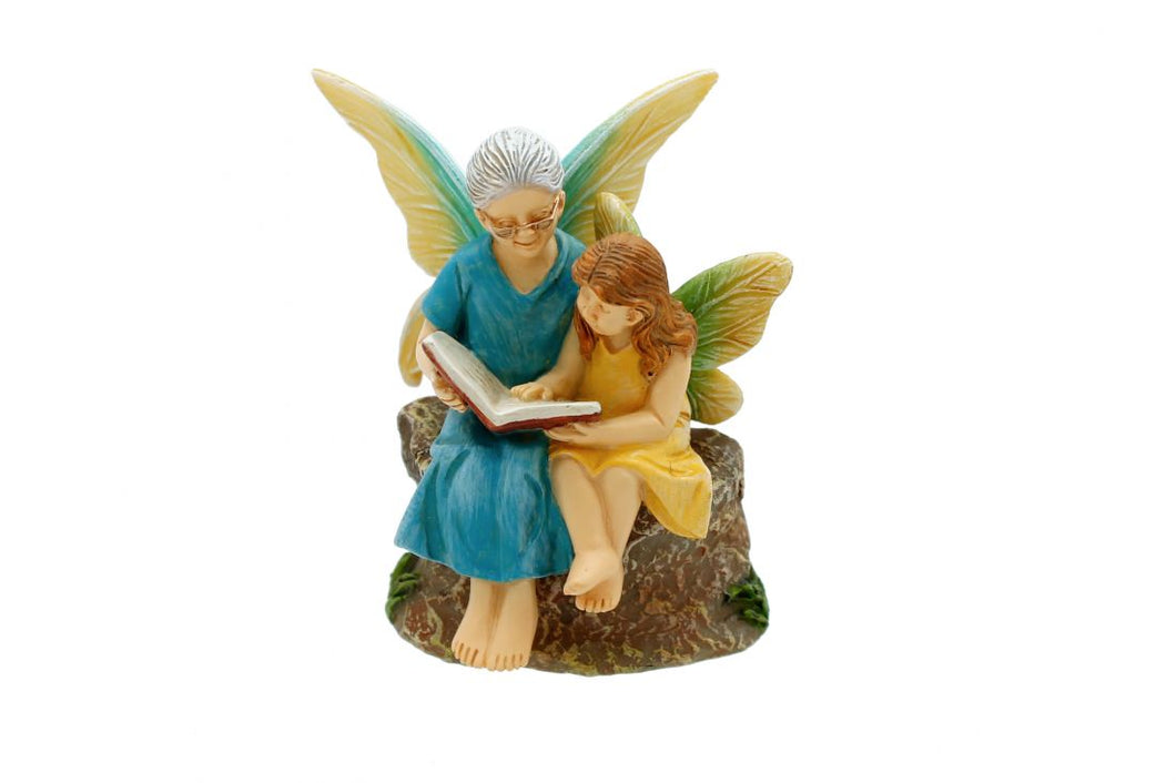 Time with Grandma fairy figurine.  Little girl reading book with Grandma. NEW 2020