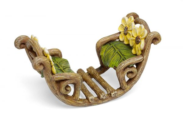 Adorable 2 person rocker with green cushions and yellow flowers