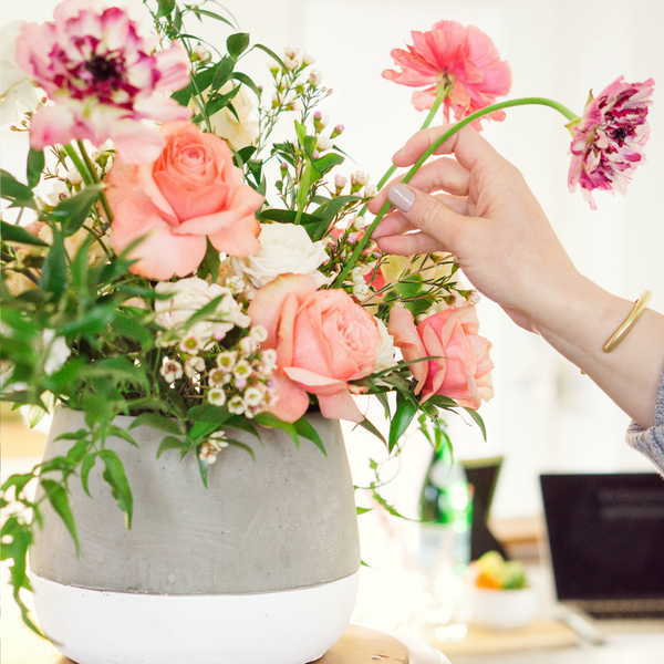Woman making a flower arrangement