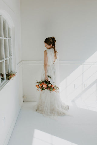 bride bouquet wedding gown back