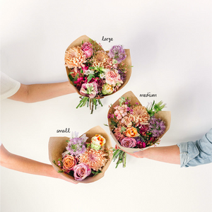 three flower bouquets wrapped in paper