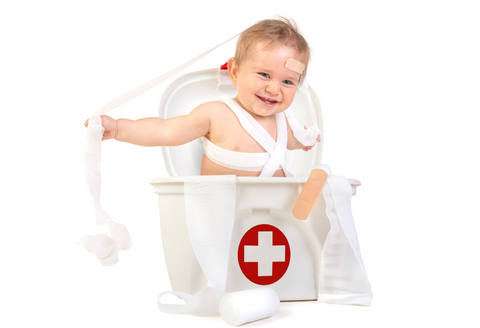 Baby with First Aid Kit
